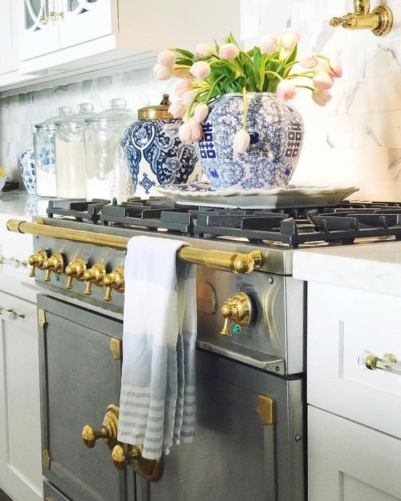 Instagram A wonderful example of how to add blue and white Chinoiserie to your kitchen. The gas stove is gorgeous.