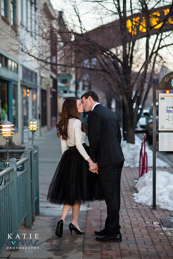 Lovely black tulle skirt and handsome black tie suit on the snowy streets of Golden Colorado's downtown.  Engagement session photos by Katie Corinne Photography.  Romantic, elegant and intimate.