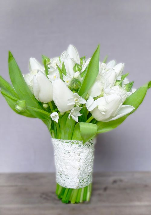 white spring flower wedding bridal bouquet. ranunculus, paperwhites and tulips