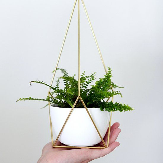 This DIY brass hanging planter is modern and gorgeous. It will make a statement in any space.