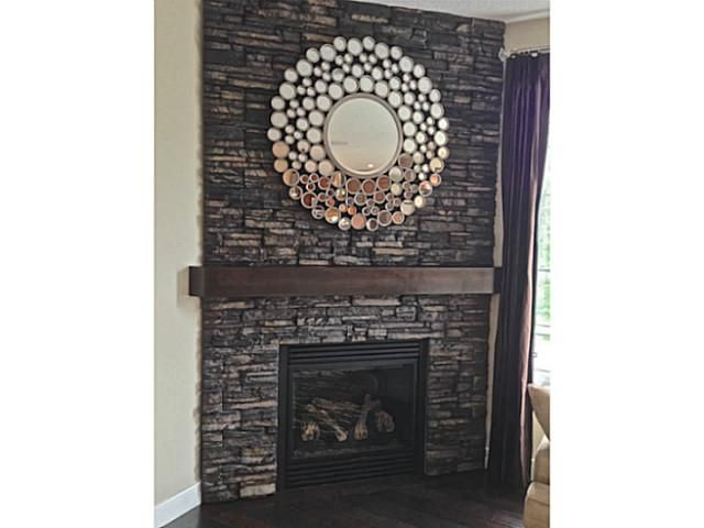 Add a little extra zing to your fireplace by adding a dramatic mirror. Great idea!