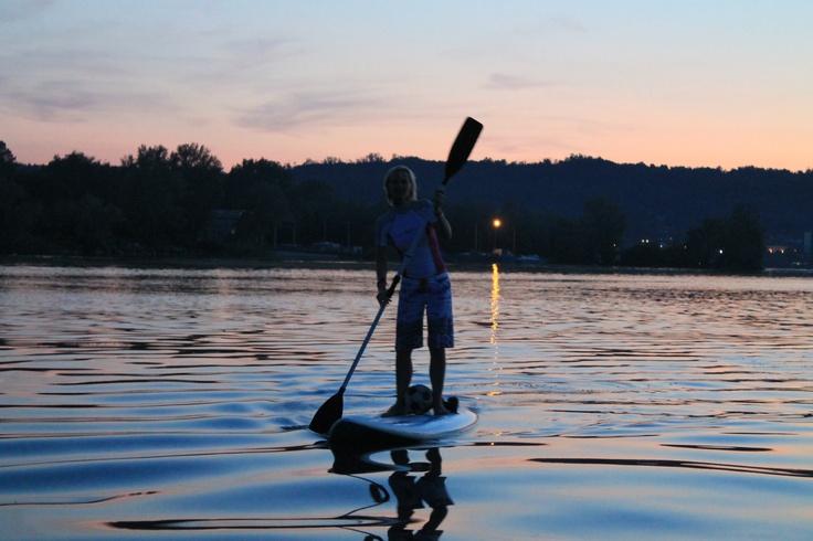 Paddle on a windsurfboard.