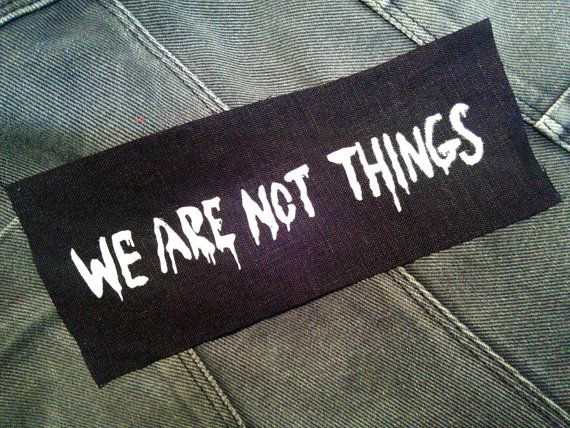 WE ARE NOT THINGS  As painted on the walls by the five wives in Mad Max Fury Road. This patch is: Screen printed from a hand cut stencil On high