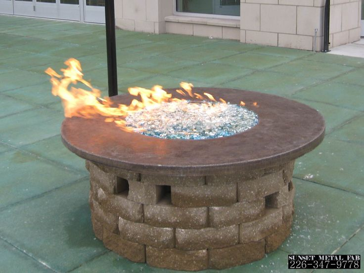 Concrete Fire Bowl by Sunset Metal Fab Inc. Perfect for residential or commercial purposes. Made in Windsor, On Canada.
