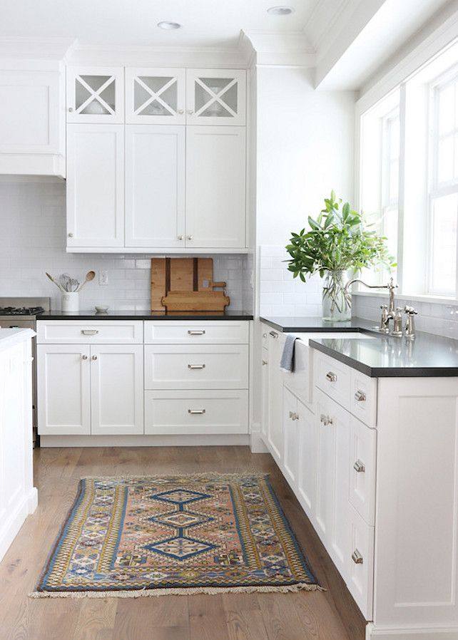 Lovely Kitchen Features White Cabinets Painted Benjamin Moore Simply White Adorned With Restoration Hardware Duluth Knobs And Pulls Paired With Honed Black