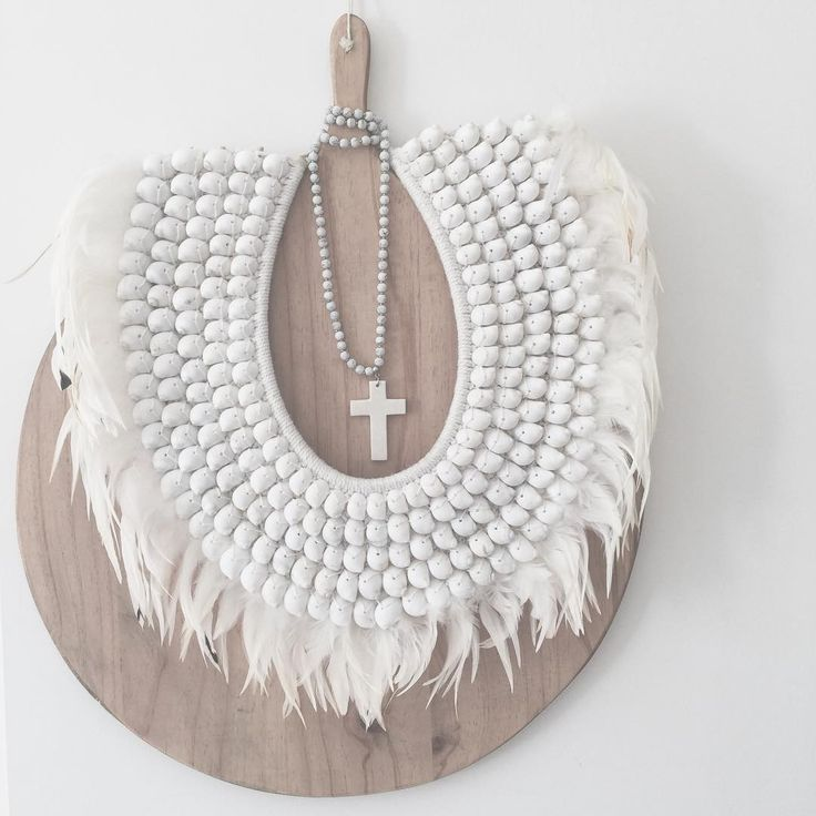 Our Sofia Tribal sitting oh so pretty on an oh so frenchie cheese board. Who needs paintings with wall beauty like this? #losari #losarihomeandwoman #homewares #styling #interiorstyling #interiordesign #sofiatribal #feathersandshells #tribalnecklace #frenchie #white #whitehome #whitewashed #whiteonwhite #texture #shells #feathers #boho #bohohome #boholuxe #scandihome See you at @life_instyle xx