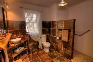 Choose where to Snooze - Karoo View Cottages bathroom with large walk in shower (wheelchair friendly)