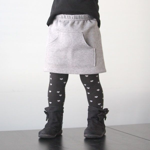 Upcycle a pair of sweatpants into a cute, comfortable kangaroo pocket skirt for a little girl with this easy sewing tutorial. Sweatshirt skirt refashion.
