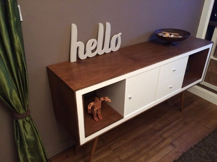 IKEA Expedit unit given a mid-century revamp with stained ply and retro legs. Brilliant.
