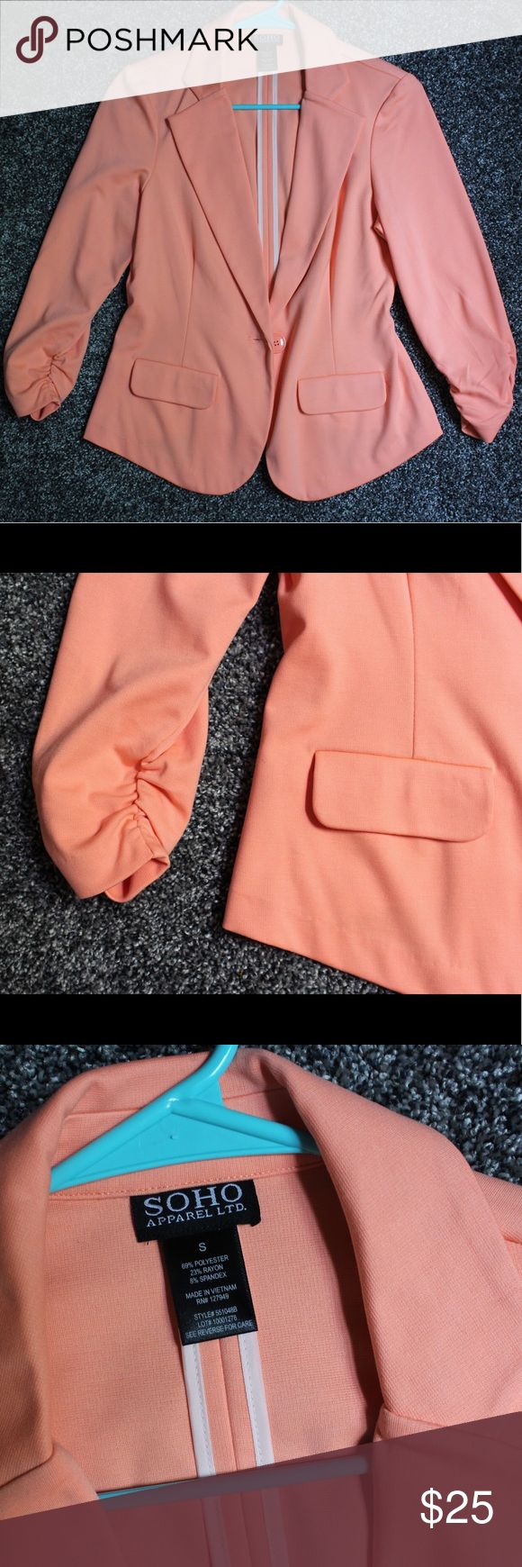 SOHO Apparel Ltd peach blazer Cute fitted peach blazer with cinched sleeves. One button for optional closure, with two decorative pockets on the front. Never worn. Can be dressed up or down. 69% polyester, 23% rayon, 8% spandex. SOHO Apparel Ltd Jackets & Coats Blazers