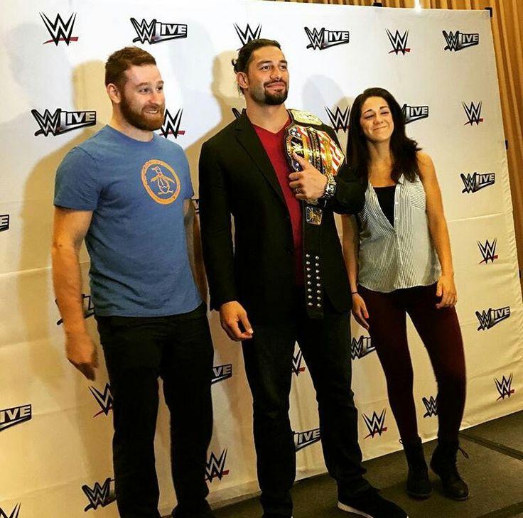 Roman Reigns with Sami Zayn and Bayley.