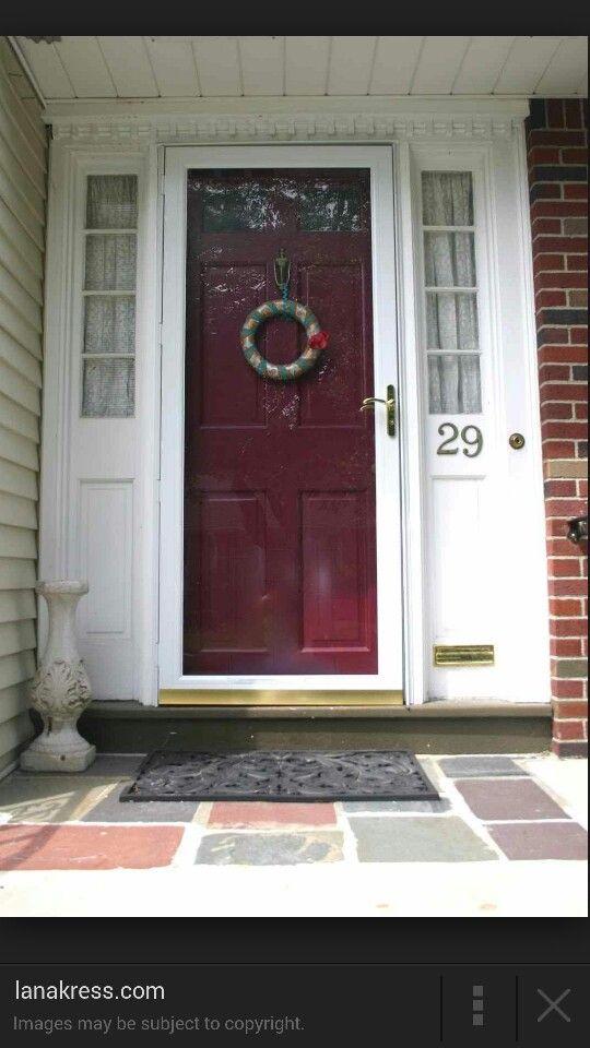 Burgundy/maroon front door brick house