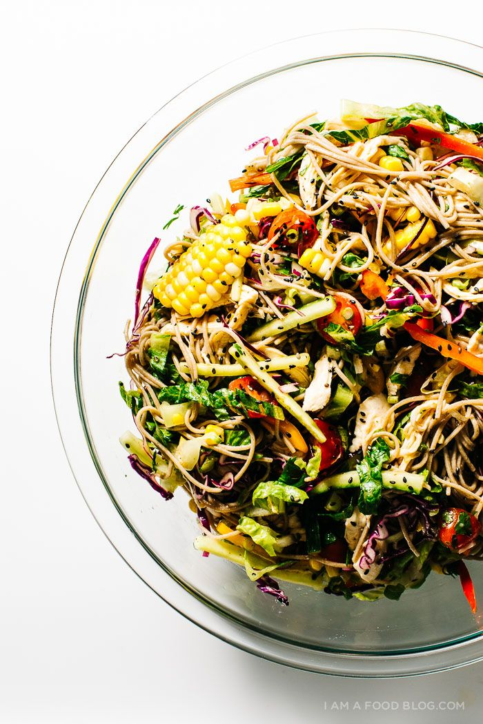 cold summer soba salad: slippery soba noodles, fresh corn, peppers, romaine, cucumbers and cabbage all in a light sesame rice vinegar dressing!