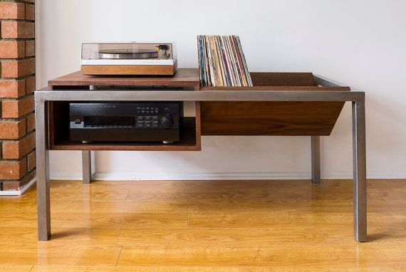 *Free shipping* Handmade media console for your turntable and records. Will hold up to 100 of your favorite vinyls and has ample storage space for receivers and other stereo equipment. Walnut plywood and 1.25 steel tubing. Available in various species of wood and metal finishes upon request. Dimensions: 51L x 24H x 23W