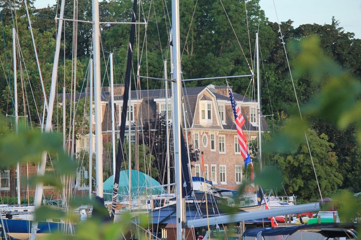 Harbour House Hotel in Niagara on the Lake through the masts at the NOTL Sailing Club
