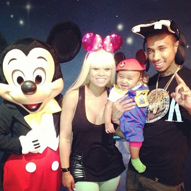 Rapper Tyga and his family hang with Mickey and Friends at the Happiest Place on Earth :)
