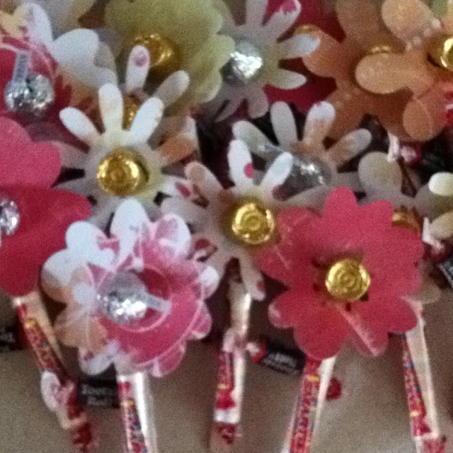 May Day flowers (rolo/kiss, smarties, and tootsie roll) cut out flowers and glue to popsicle stick. Then assemble by taping the kiss or rolo to the center of the flower. Next tape the smarties to the Popsicle stick. Finally tape the tootsie toll to the back of the stick