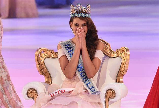 Miss South Africa and the 2014 Miss World, Rolene Strauss, reacts after being crowned during the grand final of the Miss World 2014 pageant.(Photo by AFP/Leon Neal)