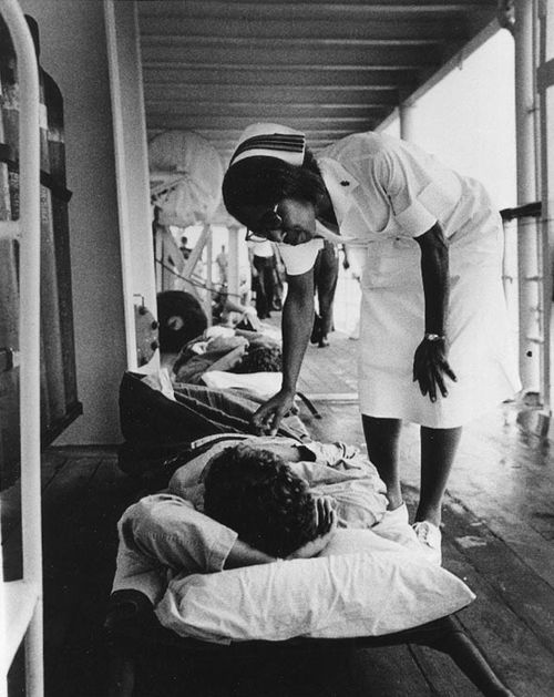 Viet Nam War. A US Navy nurse stationed on the USS Repose offers a word of encouragement to a patient about to leave the ship for further treatment in the United States, October 1967.