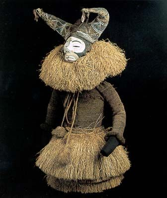 RDCongo. Initiation mask named Kisokolo and costume. Wood, fiber, cloth, pigment; 98cm (38.6″). Institut for Ethnologie der Universit�t G�ttingen