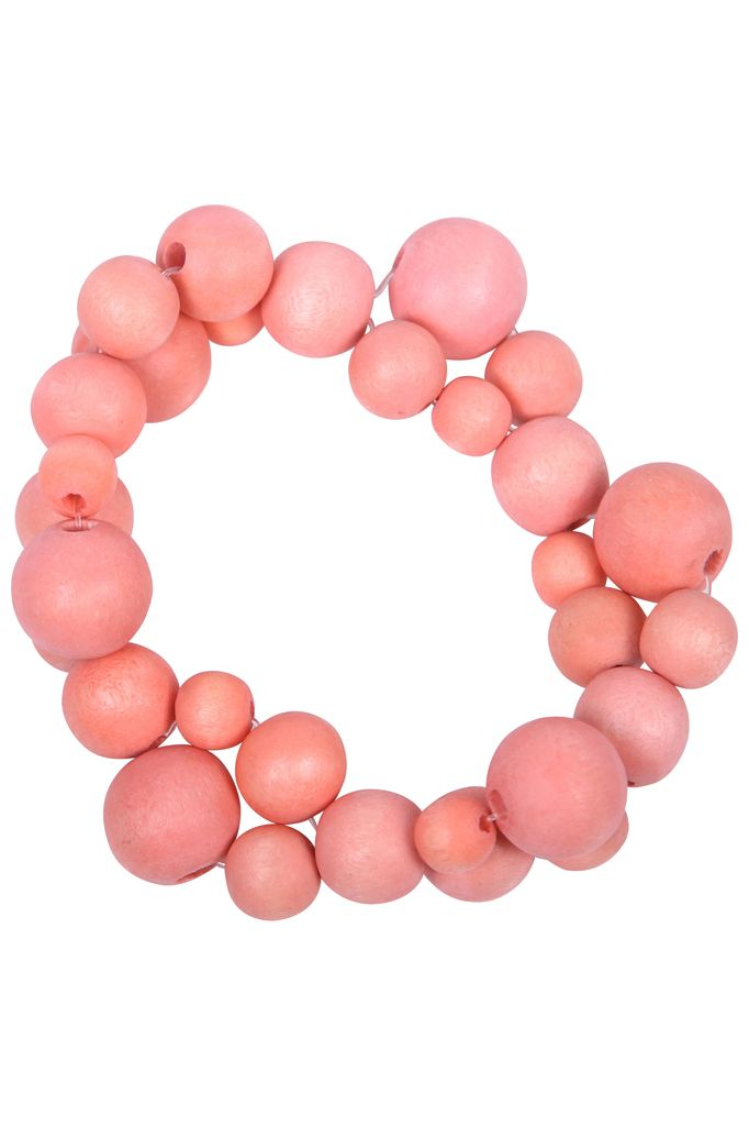 Sea Flower bracelet - Coral. Our chic wooden Sea Flower bracelet looks stunning worn day or night. Large wooden beads are strung together to create a bracelet that is lightweight and elegant. It comes in three shades; natural, coral and aquarelle and each has a matching a necklace. It has been handmade and is on an adjustable elastic band. Wooden beads on elastic band Adjustable width 70mm  lucyandalice.com.au