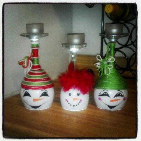 Upside down wine glasses, tea lights on top.