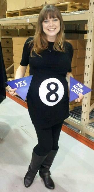 This is such a great costume! She's pregnant and puts the triangles behind her and when you ask a question, she shakes her belly and pulls out her Magic Eight Ball answer!!