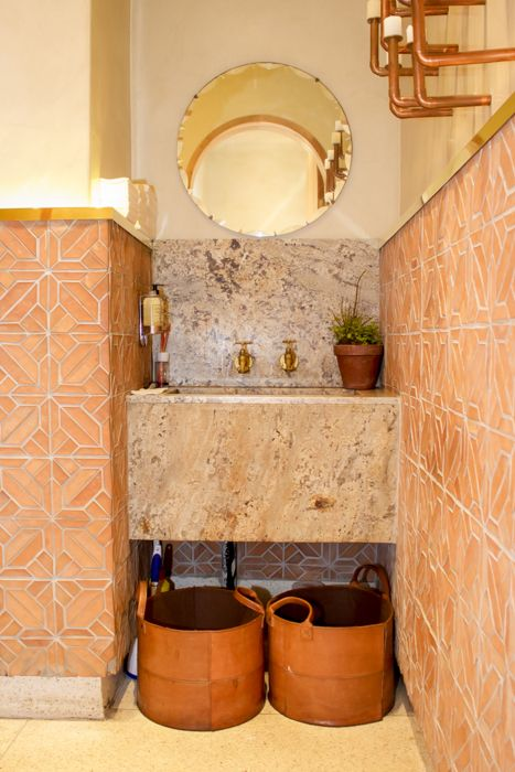 This gorgeous flamed granite bathroom vanity is complemented by the terracotta wall tiles.  We love the pairing with brass taps and the copper wall fittings.  Get your granite at www.rudischoice.co.za in South Africa and Zimbabwe!