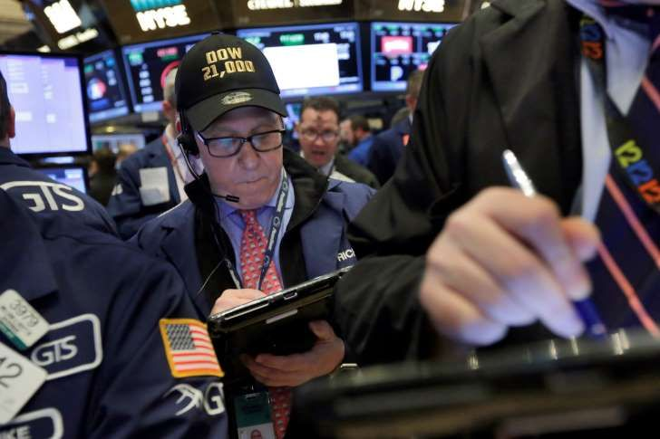 "Trader Richard Cohen wears a ""Dow 21,000"" cap as he works on the floor of the New York Stock Exchange, Wednesday, March 1, 2017. Banks and other financial companies led U.S. stocks sharply higher, pushing the Dow Jones industrial average to close above 21,000 points for the first time. (AP Photo/Richard Drew):"