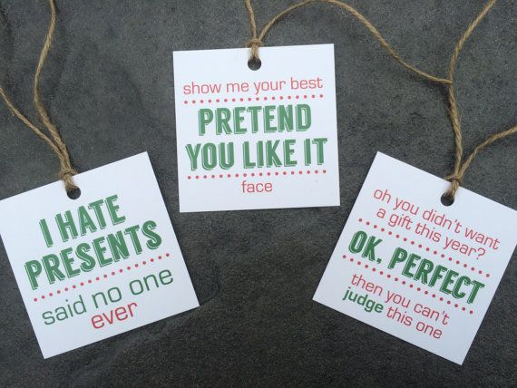 Set of 6 Holiday Gift Tags    Each set includes six gift tags with string attached, two of each variety (2 I hate presents, 2 Pretend you like it