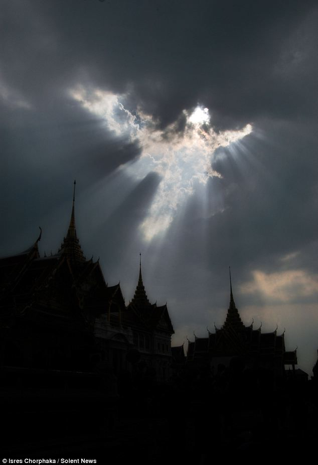 Pretty cool: Looks like a winged figure! Over the Grand Palace buddhist temple in Thailand.