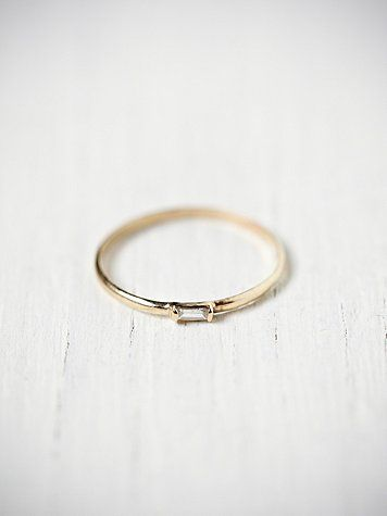 14k yellow gold ring with little rectangular baguette cut diamond embedded on the front....by Catbird
