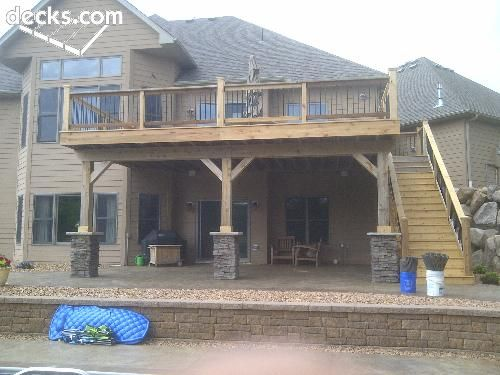 Stone on columns, then stained concrete underneath with river rocks around...