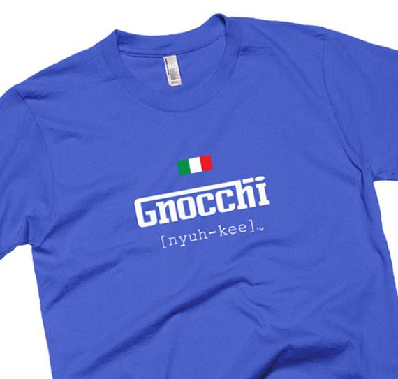 """HOT NEW ITEM! Premium Italian Pronunciation T-Shirts – """"Gnocchi"""" Pronounced: """"Nyuh-kee"""" (Nyukie)  Those of Italian descent are tired of hearing mispronunciations of their favorite Italian dishes. If you havent been living under a rock then youve probably heard various butchered attempts of menu items at your favorite dining establishments. Help cure the world of poor Italian-American dialect forever.  ***WARNING FOR NON-ITALIANS***  If you encounter someone wearing this T-Shirt at a dinner…"""