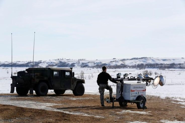 Dump trucks and heavy machinery rolled into the protest camp near the site of the Dakota Access Pipeline on Monday, and crews began filling large dumpsters with garbage that has accumulated, much of it now buried under snow.