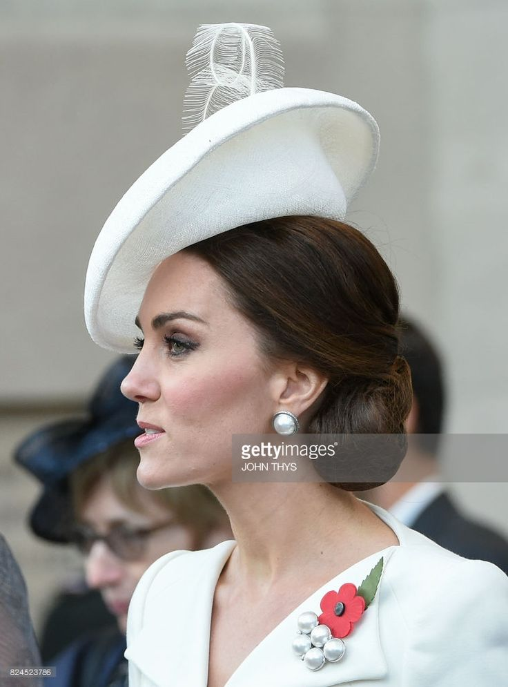 Britain's Catherine, Duchess of Cambridge attends a ceremony marking the centenary of the battle of Passchendaele, one of the bloodiest of World War I during the Last Post ceremony at the Commonwealth War Graves Commission in Ypres (Menin Gate) Memorial, in Ypres Western Flanders on July 30, 2017. The battle of Passchendaele, also called the third battle of Ypres, took place between July 31 and November 6, 1917 in Passendale, West Flanders. / AFP PHOTO / JOHN THYS        (Photo credit should…