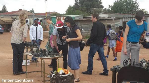 Strategic Growth Forum guest visiting Soweto with Mount Zion Tours and Travels in Soweto.