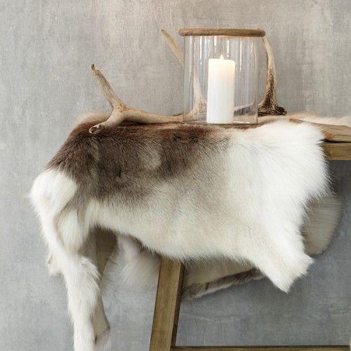 Nice rustic composition via The Design Chaser.deer hide on top of old ladder towel rack in bathroom
