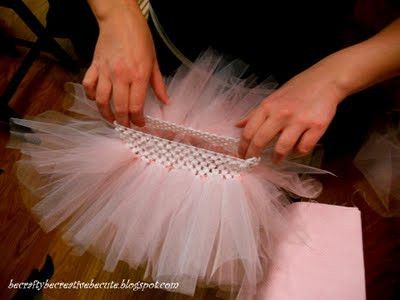 DIY Tutu. Use the holes of the headband to tie in the tule. Genius!
