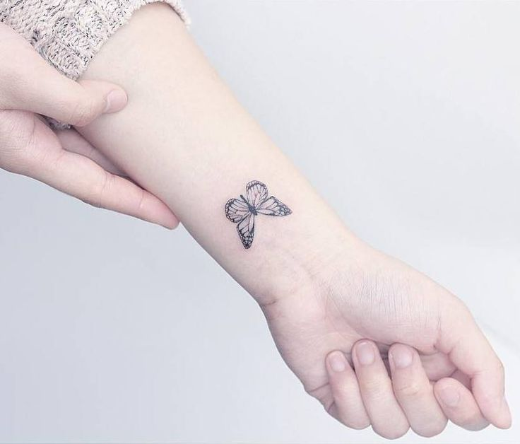 Small butterfly tattoo on the left inner wrist. Tattoo artist: Mini Lau