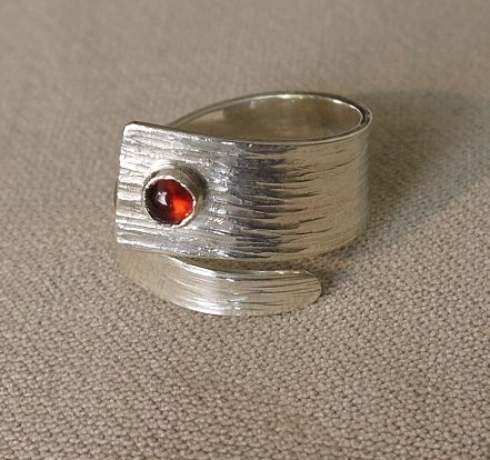Textured silver wrap ring with garnet cabochon