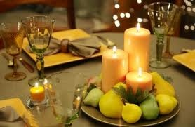 fruit centerpieces - This is pretty, we could use peaches, oranges, and grapes around the candles.