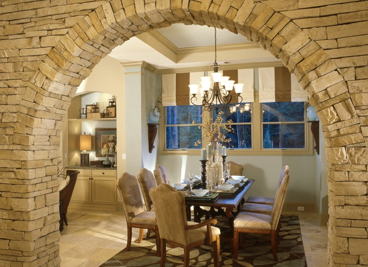 Beautiful stone arch leading into dining room hello for Kitchen dining hall design