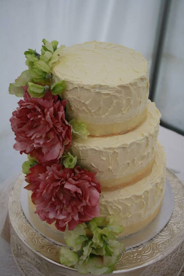 Buttercream frosted wedding cake with, pink, pale green & gold theme. Flowers are silk peonies and sweet peas