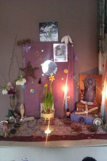 Imbolc altar with garden flowers