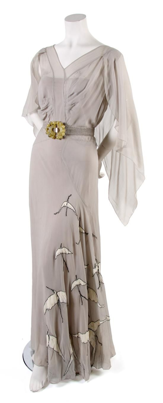 Probably 1930s French Couture Pale Blue Day Dress, bias cut with bird appliques along skirt, attached belt with art deco style clasp, low back, matching slip. From a collection of gowns found in a Boston attic and owned by the granddaughter of the founder of Tiffany.