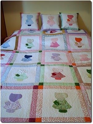 Love this Quilt. Sunboonet Sue is one my favorite quilt patterns, This is a wonderful example of it.
