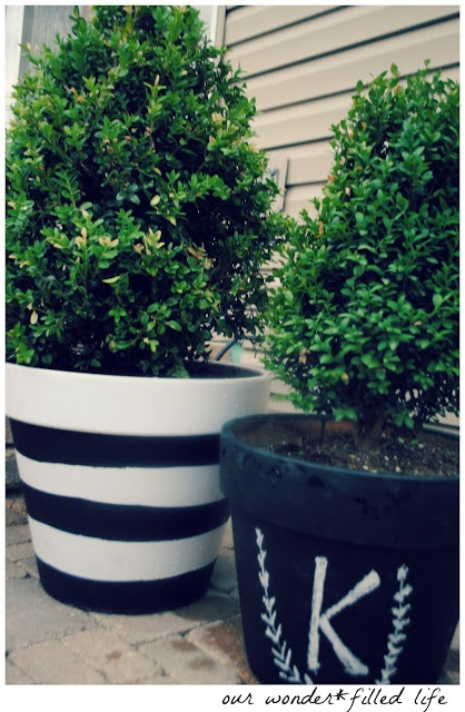 black and white flower pots....I like the one on the right