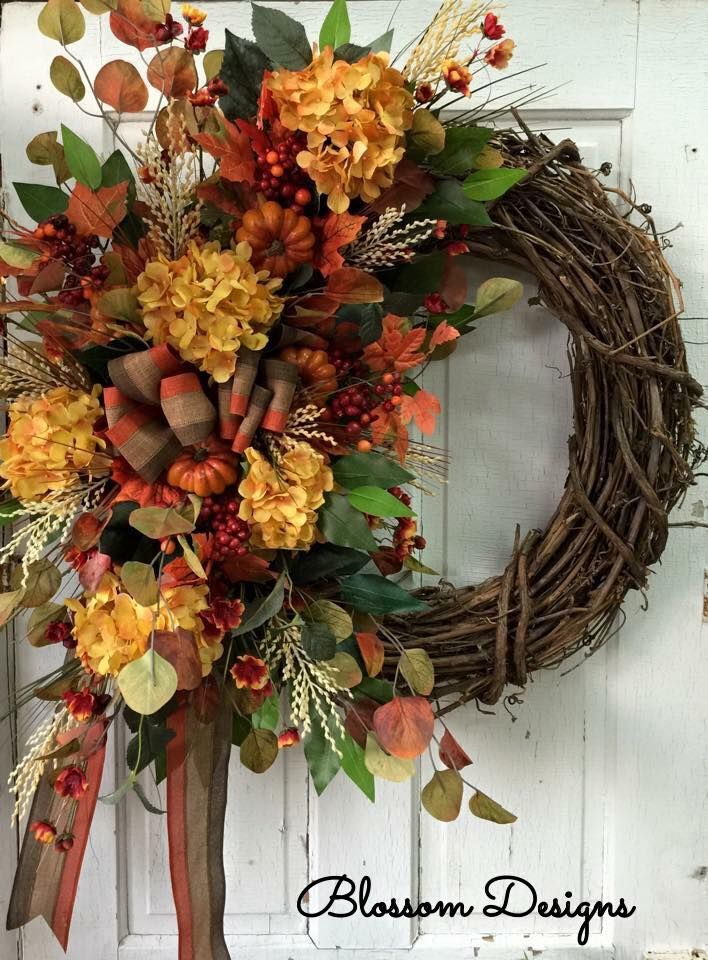 Debra Agnew designed this pretty fall wreath for her door.. You can design wreaths like this too! www.NancysInnerCircle.com