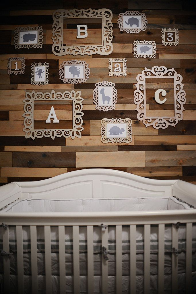 Who says newborns need brand new? Nicole would be all about the reclaimed-wood puzzle piece of a wall gracing this budget-conscious nursery. Peel-and-stick wood panels will easily give you the look of a reclaimed-wood accent wall. Lasercut-plywood frames will turn letters and animal silhouettes into fun, educational decor.